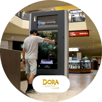 Dora gamification touch screen kiosk and logo